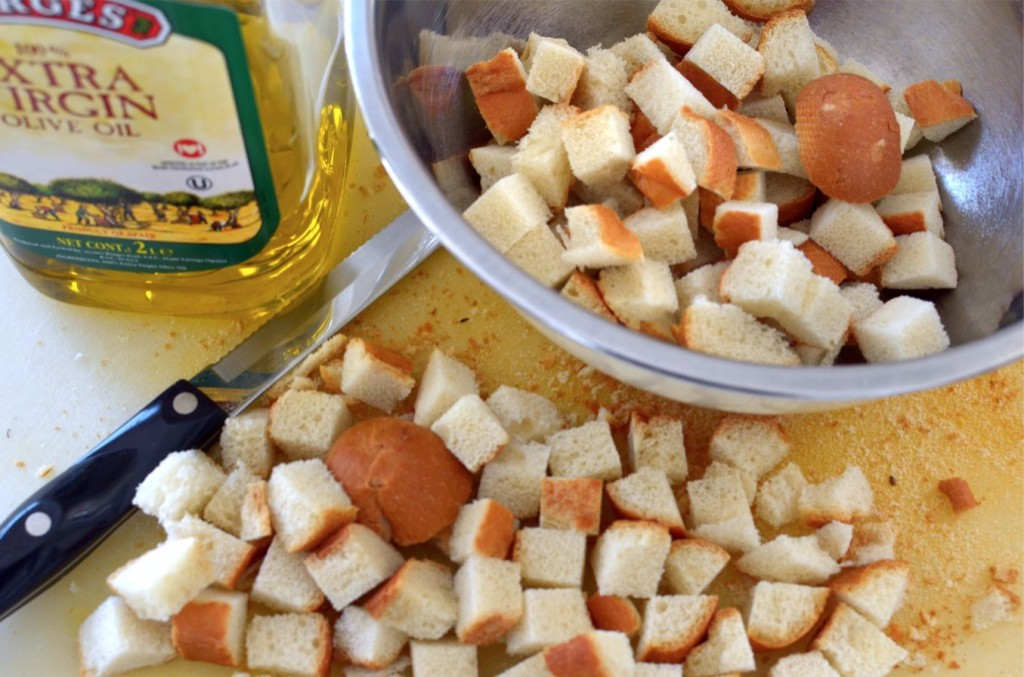 A little olive oil, parmesan cheese and leftover bread re-created into homemade croutons
